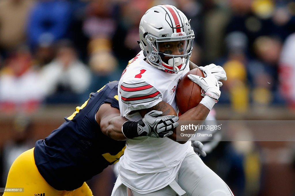 <a gi-track='captionPersonalityLinkClicked' href=/galleries/search?phrase=Terry+Richardson&family=editorial&specificpeople=758714 ng-click='$event.stopPropagation()'>Terry Richardson</a> #13 of the Michigan Wolverines tackles <a gi-track='captionPersonalityLinkClicked' href=/galleries/search?phrase=Braxton+Miller&family=editorial&specificpeople=7122480 ng-click='$event.stopPropagation()'>Braxton Miller</a> #1 of the Ohio State Buckeyes during the second quarter at Michigan Stadium on November 28, 2015 in Ann Arbor, Michigan.
