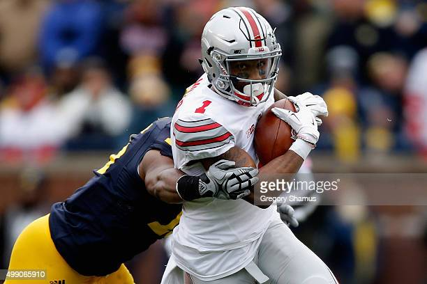 Terry Richardson of the Michigan Wolverines tackles Braxton Miller of the Ohio State Buckeyes during the second quarter at Michigan Stadium on...