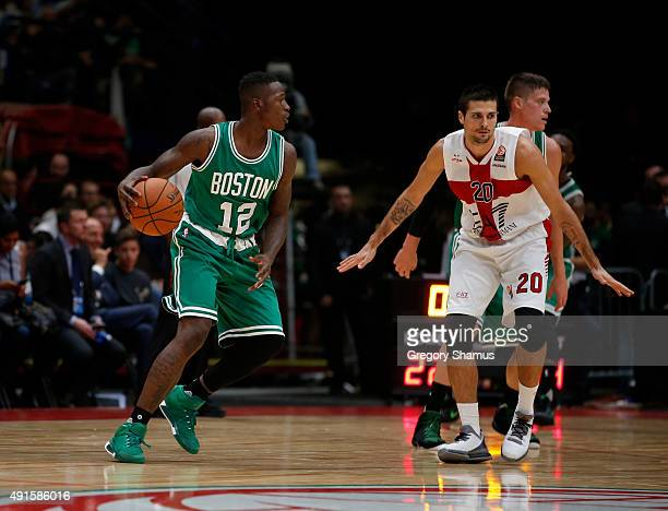 Terry Rozier of the Boston Celtics dribbles against Andrea Cinciarini of Emporio Armani Milano as part of the 2015 Global Games on October 6 2015 at...