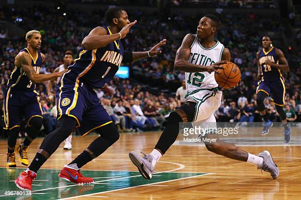 Terry Rozier of the Boston Celtics drives against Joe Young of the Indiana Pacers at TD Garden on November 11 2015 in Boston Massachusetts NOTE TO...