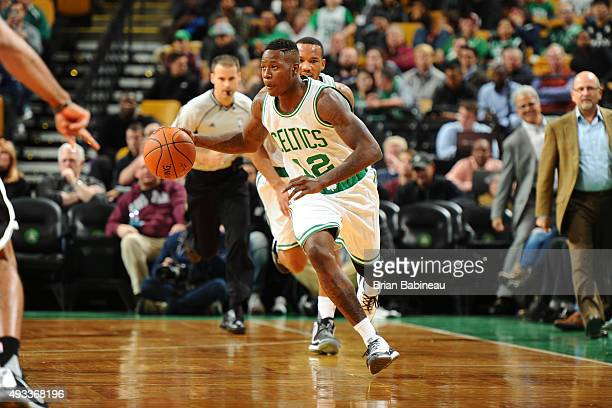 Terry Rozier of the Boston Celtics drives to the basket against the Brooklyn Nets during the preseason game on October 19 2015 at TD Garden in Boston...