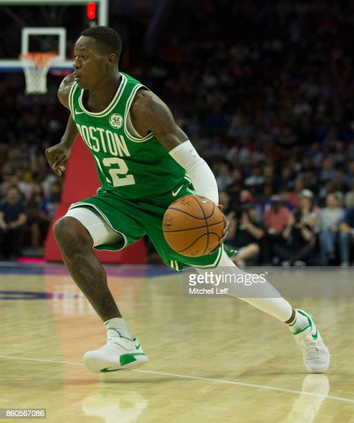 Terry Rozier of the Boston Celtics drives to the basket against the Philadelphia 76ers at the Wells Fargo Center on October 6 2017 in Philadelphia...
