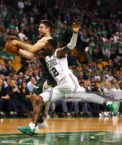 Terry Rozier of the Boston Celtics fouls Matthew Dellavedova of the Milwaukee Bucks during the fourth quarter at TD Garden on October 18 2017 in...
