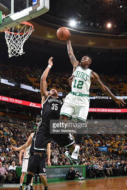Terry Rozier of the Boston Celtics goes for the layup against Justin Harper of the Brooklyn Nets during the preseason game on October 19 2015 at TD...