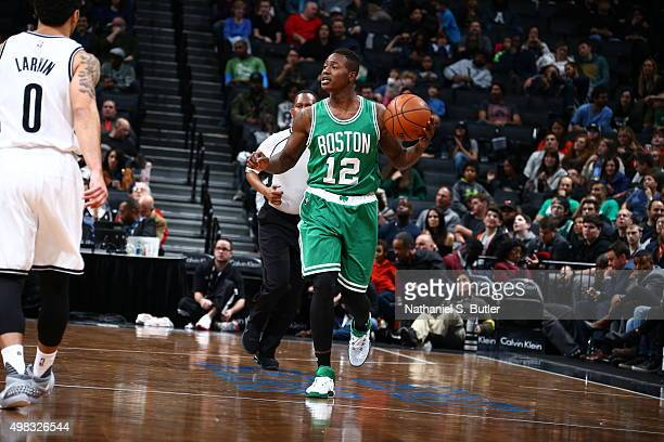 Terry Rozier of the Boston Celtics handles the ball against the Brooklyn Nets on November 22 2015 at Barclays Center in Brooklyn New York NOTE TO...