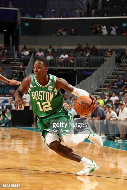 Terry Rozier of the Boston Celtics handles the ball against the Charlotte Hornets on October 11 2017 at Spectrum Center in Charlotte North Carolina...