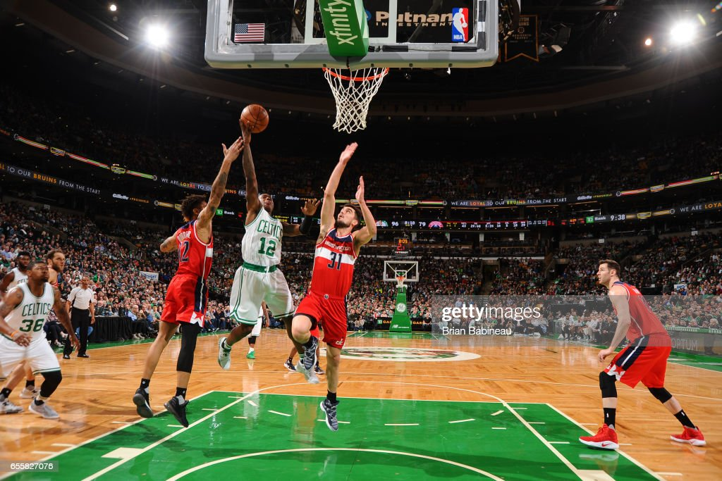 Terry Rozier #12 of the Boston Celtics shoots the ballagainst the Washington Wizards on March 20, 2017 at the TD Garden in Boston, Massachusetts.