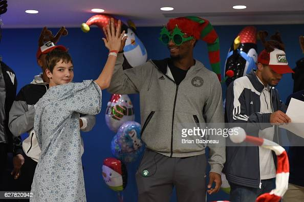 Terry Rozier of the Boston Celtics spreads holiday cheer duing a children's hospital visit on December 1 2016 at Boston Children's Hospital in Boston...