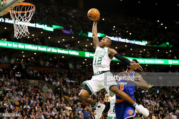 Terry Rozier of the Boston Celtics takes a shot against Justin Holiday of the New York Knicks during the second half at TD Garden on January 18 2017...