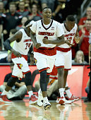 Terry Rozier of the Louisville Cardinals celebrates during the game against the Ohio State Buckeyes at KFC YUM Center on December 2 2014 in...