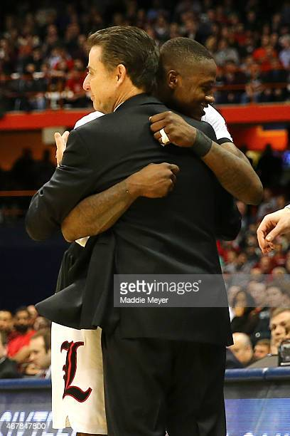 Terry Rozier of the Louisville Cardinals celebrates with head coach Rick Pitino after defeating the North Carolina State Wolfpack 75 to 65 during the...