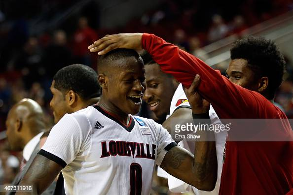 Terry Rozier of the Louisville Cardinals celebrates with his teammates after defeating the Northern Iowa Panthers 66 to 53 during the third round of...