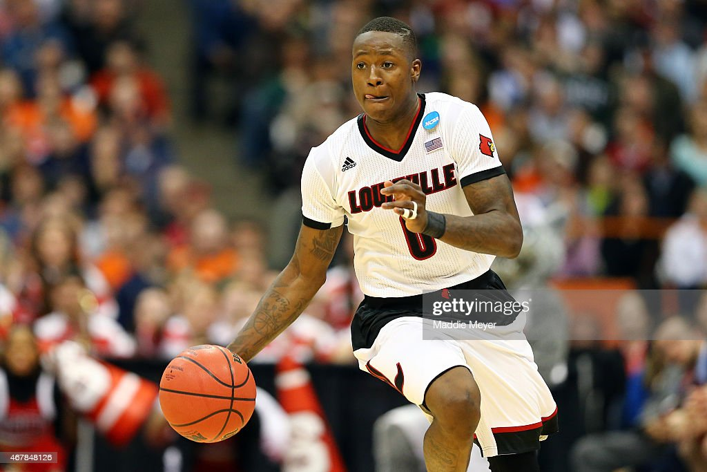 Terry Rozier of the Louisville Cardinals dribbles against the North Carolina State Wolfpack in the second half of the game during the East Regional...