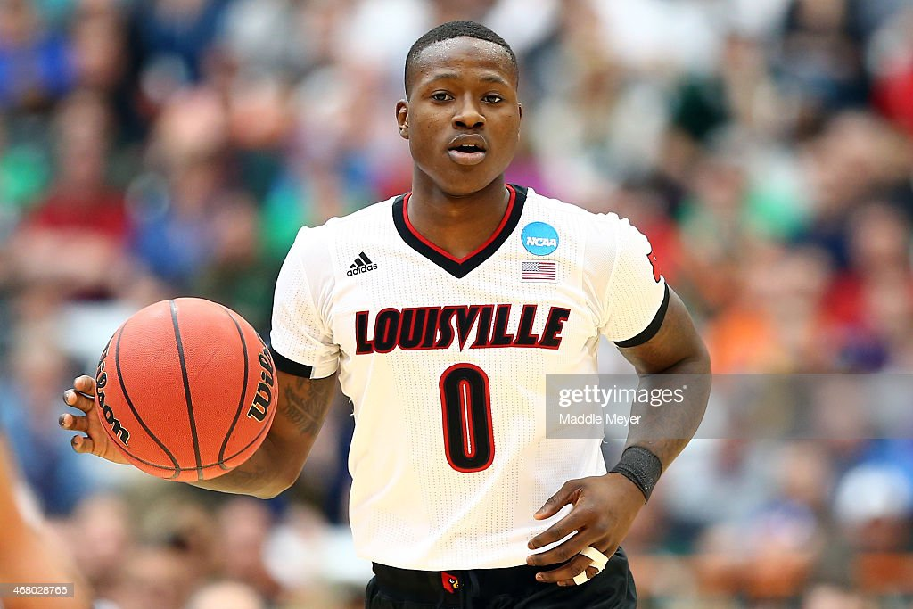 Terry Rozier of the Louisville Cardinals dribbles against the Michigan State Spartans in the first half of the game during the East Regional Final of...