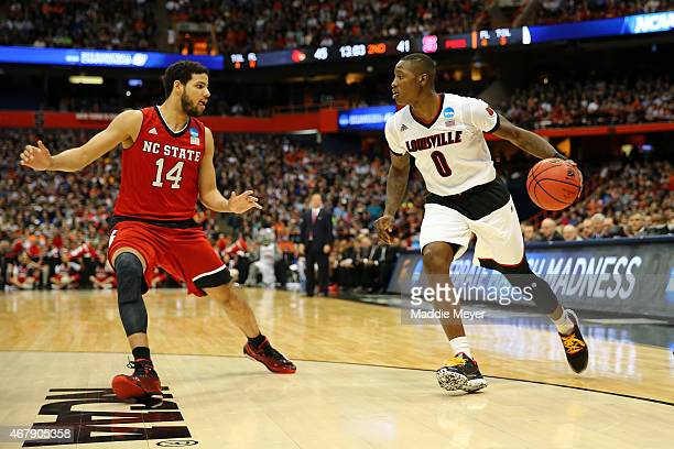 Terry Rozier of the Louisville Cardinals drives to the basket against Caleb Martin of the North Carolina State Wolfpack during the East Regional...