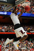 Terry Rozier of the Louisville Cardinals dunks the ball in the second half of the game against the Michigan State Spartans during the East Regional...