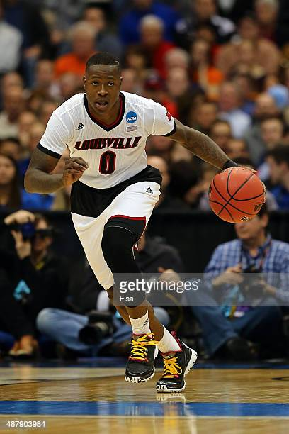 Terry Rozier of the Louisville Cardinals in action against the North Carolina State Wolfpack during the East Regional Semifinal of the 2015 NCAA...