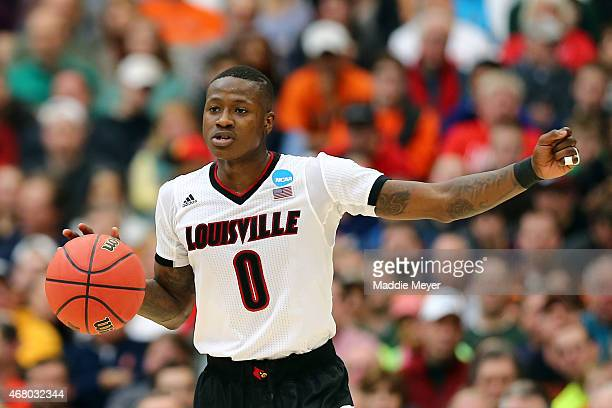 Terry Rozier of the Louisville Cardinals looks down court in the first half of the game against the Michigan State Spartans during the East Regional...