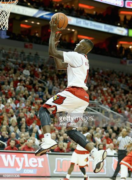 Terry Rozier of the Louisville Cardinals shoots the ball during the game against the Ohio Staste Buckeyes at KFC YUM Center on December 2 2014 in...