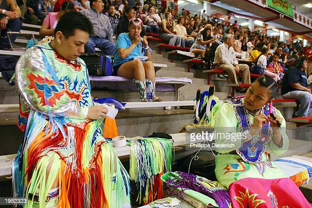 Terry St John a Dakota Indian and his fiance Crystal Cleveland a HoChunk Indian prepare to perform a traditional dance at the 20th annual Gathering...