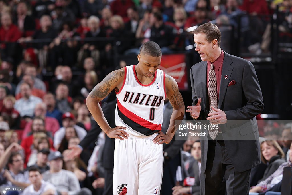 Terry Stotts and Damian Lillard #0 of the Portland Trail Blazers discuss a play during the game against the Utah Jazz on February 3, 2013 at the Rose Garden Arena in Portland, Oregon.