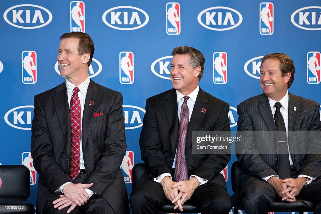 Terry Stotts, head coach of the Portland Trail Blazers, from left, Neil Olshey, the team's general manager, and Phil Kelley of Kia Motors America smile as Damian Lillard of the Blazers speaks after winning the 2012-2013 Kia NBA Rookie of the Year award on May 1, 2013 at the Rose Garden Arena in Portland, Oregon.