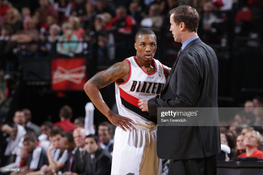 Terry Stotts of the Portland Trail Blazers talks with Damian Lillard during the game against the Chicago Bulls on November 18, 2012 at the Rose Garden Arena in Portland, Oregon.