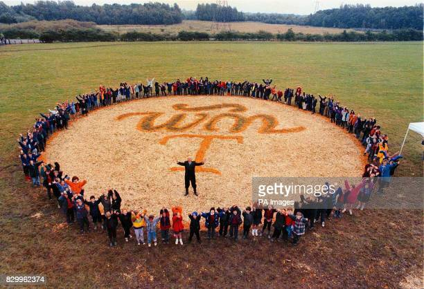 Terry Thomas Managing Director of the Coop Bank stands in the Cooperative Bank Community Woodlands Logo surrounded by the school children who made...