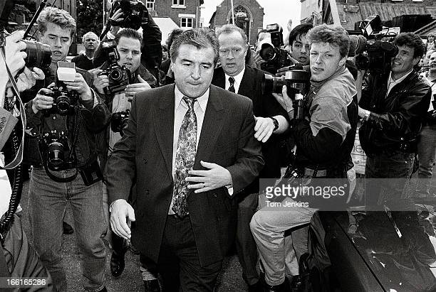 Terry Venables is surrounded by members of the press as he leaves the White Hart Lane stadium after being sacked as manager by Tottenham Hotspur...