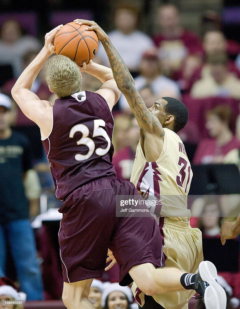 Terry Whisnant II #31 of the Florida State Seminoles fouls Trey Lindsey #35 of the Louisiana-Monroe Warhawks during the game at the Donald L. Tucker Center on December 17, 2012 in Tallahassee, Florida. Florida State won 63-48.