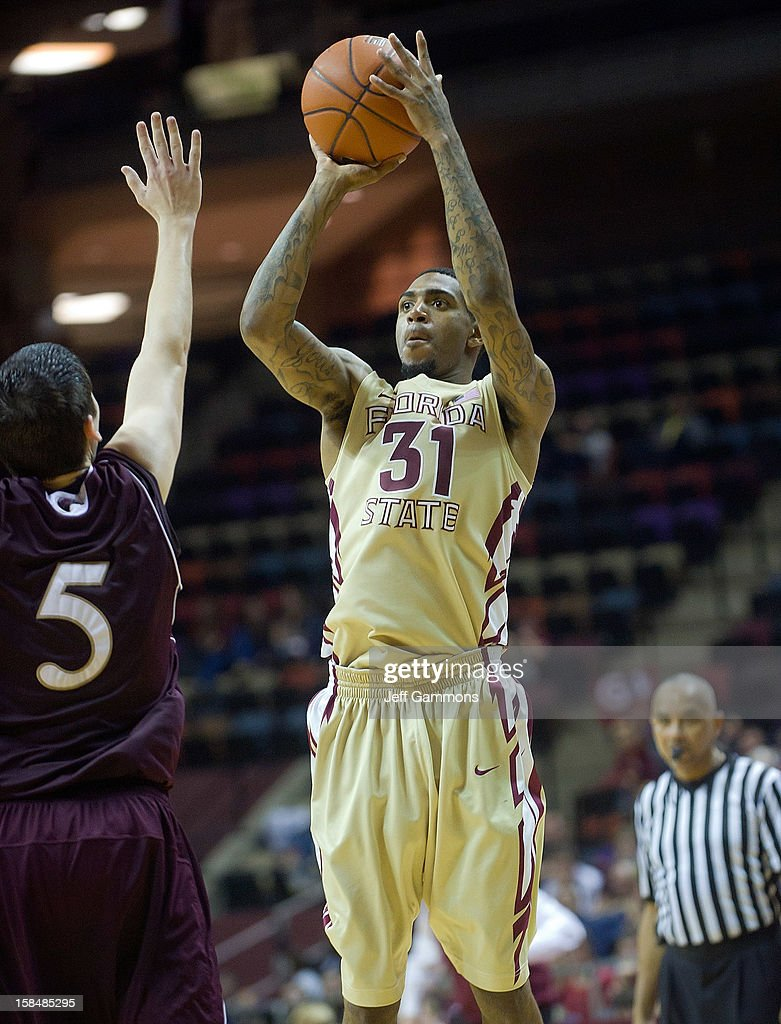 Terry Whisnant II #31 of the Florida State Seminoles shoots for three as Trent Mackey #5 tries to block during the game at the Donald L. Tucker Center on December 17, 2012 in Tallahassee, Florida. Florida State won 63-48.