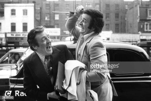 Terry Wogan broadcaster and writer cavorts with fellow broadcaster Eamonn Andrews