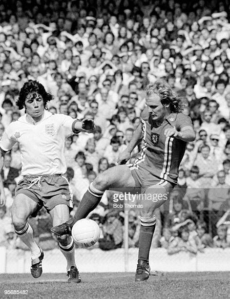 Terry Yorath of Wales is challenged by England's Kevin Keegan during the Home Championship International match at Ninian Park in Cardiff 8th May 1976...