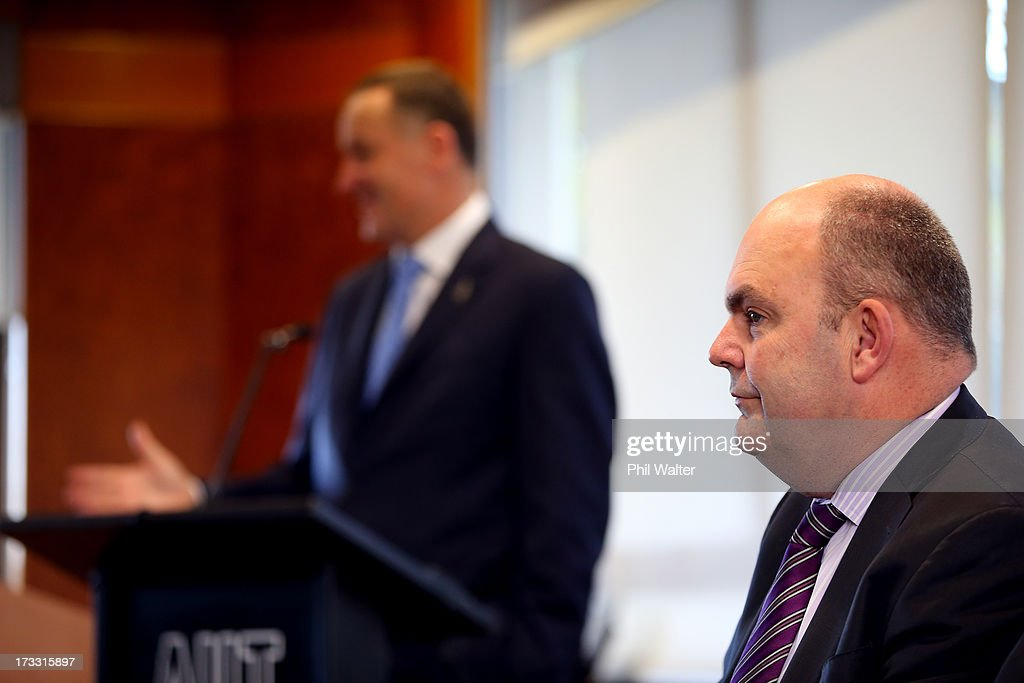 Tertiary Education, Skills and Employment Minister Steven Joyce looks on as Prime Minister <a gi-track='captionPersonalityLinkClicked' href=/galleries/search?phrase=John+Key&family=editorial&specificpeople=2246670 ng-click='$event.stopPropagation()'>John Key</a> speaks at the Auckland University of Technology's Manukau Campus on July 12, 2013 in Auckland, New Zealand. The Government today announced a major expansion to the Manukau Campus, which will see the number of full time students increase from the current 940 to 4100 by 2020.