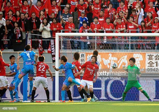 Teruaki Kobayashi of Sagan Tosu scores his team's first goal during the JLeague match between Sagan Tosu and Urawa Red Diamonds at Best Amenity...