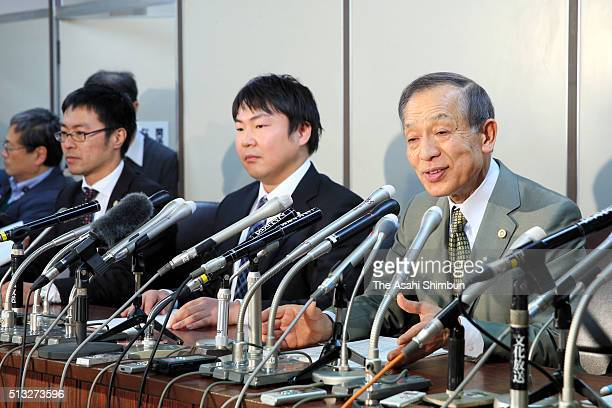 Teruhiko Asaoka and other lawyers for the defendants speak to reporters during a press conference after the Supreme Court ruling on March 1 2016 in...