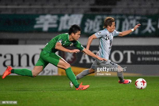 Teruhito Nakagawa of Avispa Fukuoka and Tatsuya Uchida of Tokyo Verdy compete for the ball during the JLeague J2 match between Tokyo Verdy and Avispa...