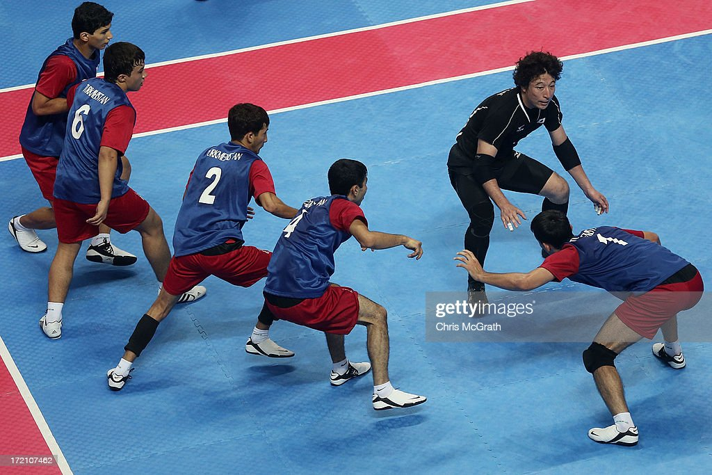 Terukazu Nitta #4 of Japan faces off with the Turkmenistan defence during the Kabaddi Men's Team Preliminary Match between Turkmenistan and Japan at Ansan Sangnoksu Gymnasium on day four of the 4th Asian Indoor & Martial Arts Games on July 2, 2013 in Incheon, South Korea.