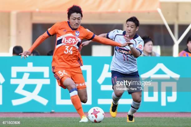 Teruki Hara of Albirex Niigata and Hiroki Kawano of FC Tokyo compete for the ball during the JLeague J1 match between Albirex Niigata and FC Tokyo at...