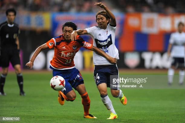 Teruki Hara of Albirex Niigata and Jun Amano of Yokohama FMarinos compete for the ball during the JLeague J1 match between Albirex Niigata and...