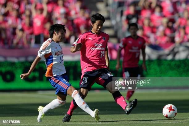 Teruki Hara of Albirex Niigata and Kazuya Yamamura@of Cerezo Osaka compete for the ball during the JLeague J1 match between Cerezo Osaka and Albirex...