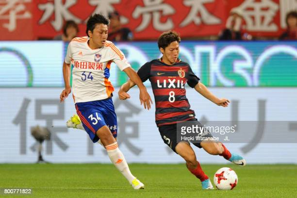 Teruki Hara of Albirex Niigata and Shoma Doi of Kashima Antlers compete for the ball during the JLeague J1 match between Kashima Antlers and Albirex...
