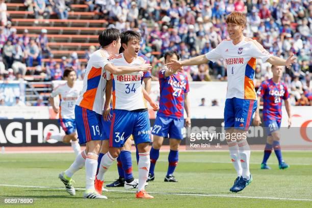 Teruki Hara of Albirex Niigata celebrates scoring the opening goal with his team mates Kisho Yano and Song Ju Hun during the JLeague J1 match between...