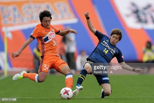 Teruki Hara of Albirex Niigata is tackled by Junya Ito of Kashiwa Reysol during the JLeague J1 match between Albirex Niigata and Kashiwa Reysol at...