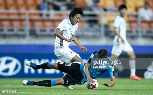 Teruki Hara of Japan challenges Rodrigo Bentancur of Uruguay during the FIFA U20 World Cup Korea Republic 2017 group D match between Uruguay and...