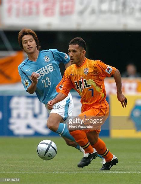 Teruyoshi Ito of Shimizu SPulse and Takashi Fukunishi of Jubilo Iwata compete for the ball during the JLeague match between Shimizu SPulse and Jubilo...