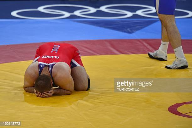 US' Tervel Ivaylov Dlagnev reacts after being defeated by Uzbekistan's Artur Taymazov in their Men's 120kg Freestyle semifinal match on August 11...