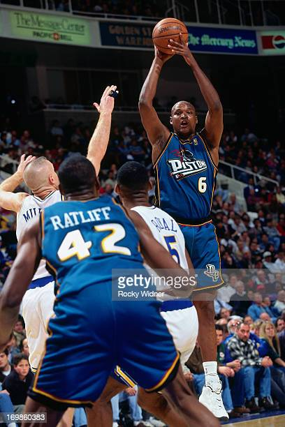 Tery Mills of the Detroit Pistons shoots the ball against the Golden State Warriors during a game played on January 23 1997 at the San Jose Arena in...