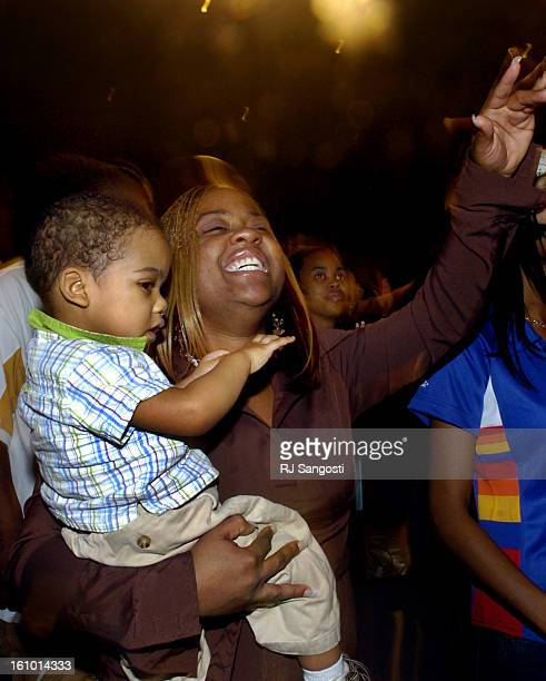 DENVER COLO FEB 19 2005 Tesa<CQ> Brice<CQ> holding her son 22monthold D'Marus<CQ> Brice<CQ> of Denver dances to music at the AllStar Gospel music...