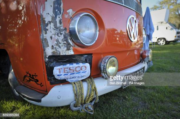 A Tesco carrier bag is taped over the indicator of a VW Baywindow Type 2 Transporter at Vanfest festival in the Three Counties Showground Malvern...